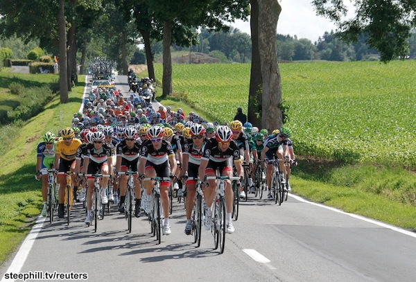 The peloton rides during the 198 km (123 miles) first stage of the 99th Tour de France cycling race between Liege and Seraing