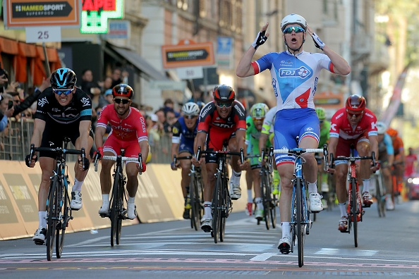 French rider Arnaud Demare (R) celebrates as he crosses the finish line to win the 107th edition of the Milan - San Remo cycling race on March 19, 2016 in San Remo. Arnaud Demare won the 295 km race ahead British Ben Swift of Team Sky (L) and Belgian Jurgen Roelandts.  / AFP / MARCO BERTORELLO        (Photo credit should read MARCO BERTORELLO/AFP/Getty Images)